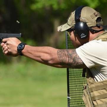 Guy Firing Pistol